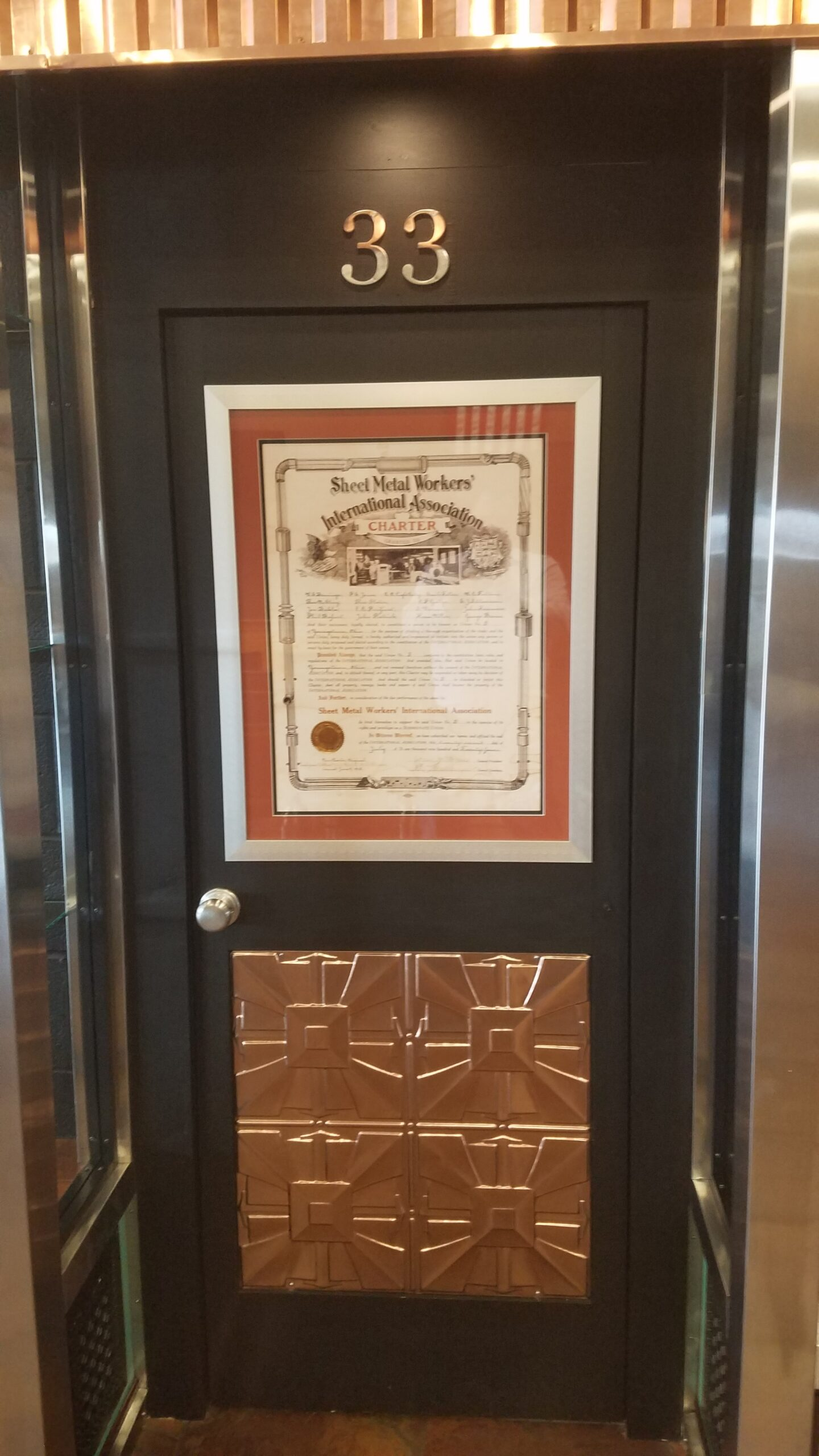 Showcase's Door Showing Youngstown's Original Charter from 1888.
