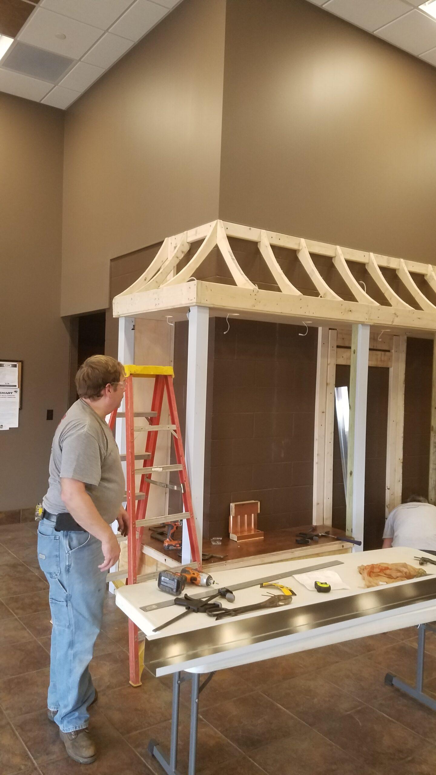 Youngstown Retiree, Bill Kuebler, Installing Stainless Steel Column Guards.